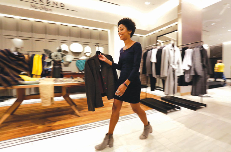 Luxury stores add more amenities to lure shoppers in a tougher retail market